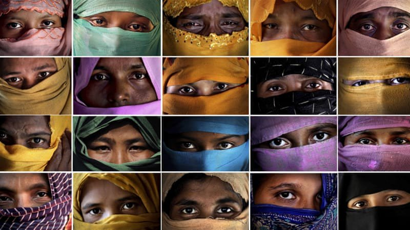 Women with faces covered except for eyes
