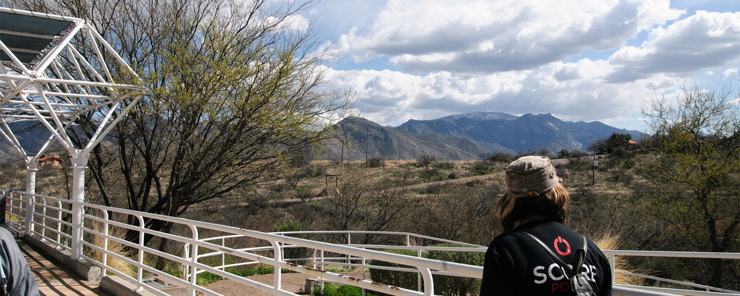 Student walking along Biosphere2 taking in the scenery