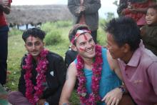 MDP student sitting with his collaborators in Nepal, summer 2019