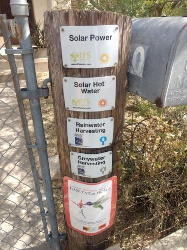 Solar and water harvesting signs