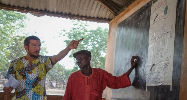 Jake, at left, leading a session on malaria prevention